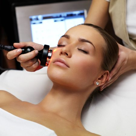Woman lies on a table in a beauty spa getting a treatment